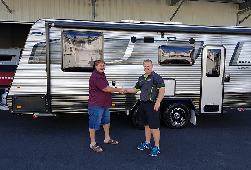 Customer David Gattera taking delivery of his new Coromal from Justin Gorrie